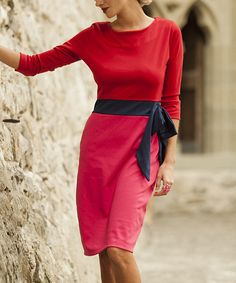 Combining timeless and trendy style elements, this dress is a fabulous feminine find. Color blocking adds vibrant appeal, while the waist-cinching silhouette makes this a fast favorite.