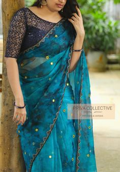 Pv 4247 navy blue and blue tie dye. Blue and blue tie dye organza sari with yellow mirror work bhutti all over is finished with navy bl Netted Blouse Designs, Cotton Saree Blouse Designs, Wedding Saree Blouse Designs, Fancy Blouse Designs, Dress Designs, Blouse Patterns, Fancy Sarees Party Wear, Stylish Blouse Design, Stylish Sarees