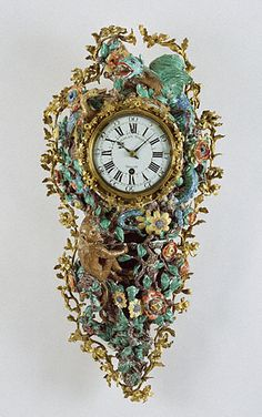Gorgeous 18th c. French wall clock - movement by Charles Voisin; case made at Chantilly Porcelain Manufactory, 1740.  It's decorated with a monkey playing in a tree, flowers, and a green dragon. It's made of soft-paste porcelain, gilt bronze, & enameled metal - it's 2 ft, 5 1/2 in. tall.  Such 'pendule d'alcove' clocks were designed for bedrooms & were fitted cords that struck on the hour and 1/4 hour when pulled, thus eliminating the need to light a candle to tell time. (1st of two pins)