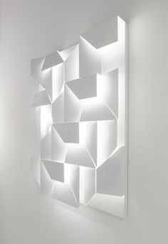'Wall Shadows Lighting' by Charles Kalpakian. Embeded LED lamps into 3D wall panel.