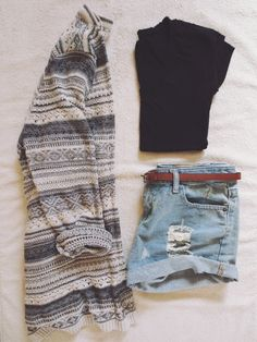 Patterned sweater cardigan, fitted cropped black t shirt, distressed high waisted denim shorts