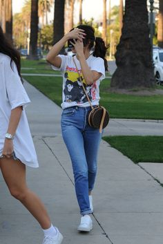 Selena Gomez wearing Louis Vuitton Petite Boite Chapeau Bag, Puma Basket  Velcro Sneakers, Re done High Rise Jeans and Rta Summer 92 Shirt 4e90c1465658