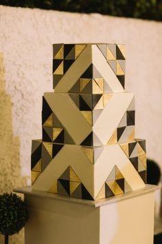 Modern black, white, and gold square wedding cake