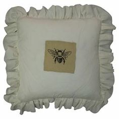 """A perfect addition to your sofa, bed, or chaise, this burlap pillow showcases a bumble bee motif and a ruffled border.  Product: PillowConstruction Material: Cotton and burlap coverColor: CreamFeatures:  Large double-edge rufflePrinted beeInsert included Dimensions: 20"""" x 20""""Cleaning and Care: Dry clean only"""