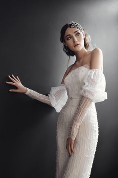 Off the shoulder Chantilly #Solstiss lace fitted gown, with long puff sleeves, intricately embroidered by hand with #Swarovski crystals and pearls.