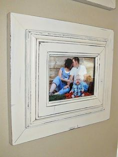 DIY:  Glue two frames together for a chunkier look and if they don't match, paint them!  This frame was distressed with sandpaper.