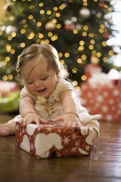 How to Take Photos of Your Kids in Front of the Christmas Tree by Sandra Ketcham, globalpost. Image credit:  Jupiterimages/BrandX/GettyImages #Photography_Tutorial #Christmas