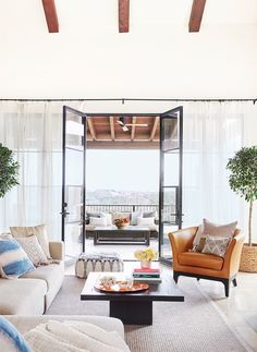 Sheer Curtains The quickest way to let light in starts at the source. Replace heavy fabric curtains with gauzy ones, making sure the panels go all the way to the floor.  Saved from:http://www.goodhousekeeping.com/home/decorating-ideas/g1500/decor-ideas-living-room/?slide=5