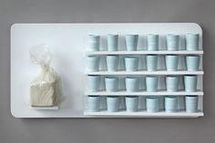 Hope Rovelto, wood panel, 25lb bag of porcelain, wheel thrown cups    http://artaxis.org/ceramics/rovelto_hope/hope_rovelto.html