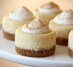 Serve these mini Eggnog Cheesecakes alongside tart cranberry puree.