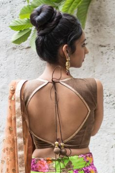 Ready to shop blouses | House Of Blouse Ready to shop blouses | House Of Blouse textured brown jute brocade - Redefine sensual elegance in this earthy brown round neck blouse. The sparkle at the neckline and the back is added by placing a slim dull copper border. This simple timeless blouse may fast become your go to, multi-occasion blouse. For enquiries Whatsapp +91 81050 68601. *Shipping worldwide* #saree #blouse #sareeblouse #blousedesigns #desi #indianfashion #india #bollywood #brown