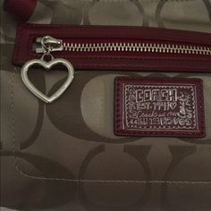 NWOT- Authentic Coach Poppy cross body Cross body style with long detachable strap. Also can be carried by single shoulder/arm strap. In perfect-mint condition, NEVER used. Bag is small with front zipper that has heart on it. Also has inside zipper. PLEASE NO TRADES OR OFFERS Coach Bags Crossbody Bags
