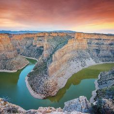 Three Days of Water, photograph by @ladzinski [3 of 10] A colorful sunset illuminating the sky and walls of Bighorn Canyon in southeast Montana. In an area that receives 18-20 inches of rain fall annually, the Bighorn River serves as critical resource for local wildlife. Sponsored by @StellaArtois: With a lack of access to clean water throughout the world, people spend hours each day collecting water for their families, stifling their chances for opportunities such as education and…