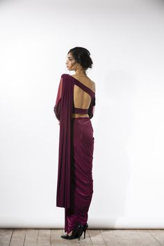 Wine three piece sari with a one-shouldered silk blouse with beading silk straight pants and a pre-stitched jersey sari drape. Hand-embroidered with tone-on- Indian Attire, Indian Wear, Indian Dresses, Indian Outfits, Indian Clothes, Saree Jackets, Look Short, Indian Blouse, Indian Sarees