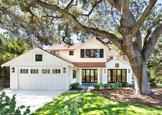 Credit to Chase  Arnold Inc Chic Black Trim in Exterior Farmhouse with Ravishing Waterfront House Plans Stilts  next to Aesthetic Brown Roof  alongside Artistic White Exterior  and Elegant Attached Garage