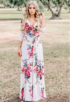 4613dc50a A woven maxi dress featuring an allover floral print, a V-neckline with a