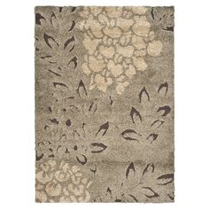 Anchor your dining set or living room seating group in style with this chic shag rug, showcasing a floral-inspired motif in smoke and dark brown.