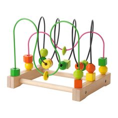 IKEA MULA Bead roller coaster Moving wooden beads on a track is a fun way to learn about colours and shapes.