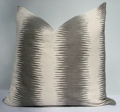 """18"""" x 18"""" grey and cream ikat stripe pillow cover. $25.00, via Etsy."""