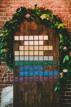 Jewel-tone escort card wall: http://www.stylemepretty.com/california-weddings/long-beach-ca/2015/11/03/mod-geometric-rustic-wedding-at-the-loft-on-pine/ | Photography: OneLove - http://www.onelove-photo.com/