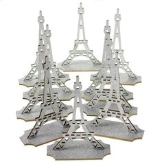 Paris Eiffel tower made of wood and design with a sparkling coating of glitter. Perfect decoration as cake topper or table centerpiece for your birthdays, weddings and etc. Eiffel tower comes with a f