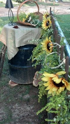 OR maybe I should go more this route with sunflowers....hmm....  Love this country western wedding decor