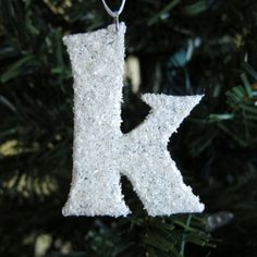 Snow covered initial ornaments made with white glitter and a liquid resin.