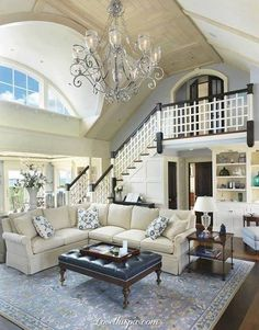 High Ceiling Homes modern living room with high ceiling, hardwood floors,  carpet