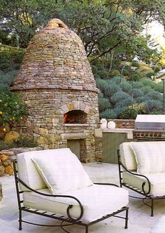 Would love this unique beehive fireplace in the garden.