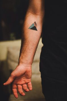 Layered triangles representing mountains