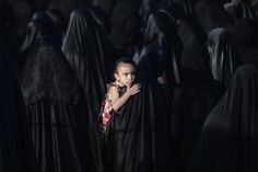 A Bahraini girl is carried by her mother during the funeral of Sayed Omran Sayed Hameed, in the village of Karzakkan, south of Manama - by Mohamed Al-Shaikh, Bahrain Pictures Of The Week, Great Pictures, Vanity Fair, Fotojournalismus, Burn Injury, Portraits, Documentary Photography, Photos Du, People Around The World