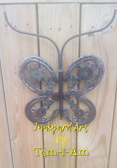 Junkyard Art by Tam-I-Am.  Repurposed horseshoes and nuts create a butterfly.  Scrap metal art.