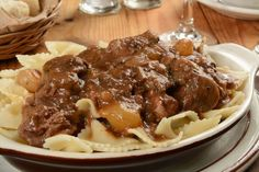 "Beef Bourguignon is a typical French meal that is a delicious beef stew, cooked in red wine, that comes from the Burgundy region of France. I JUST DON""T SERVE IT WITH PASTA! Beef Dishes, Food Dishes, Main Dishes, Beef Recipes, Cooking Recipes, Recipies, Yummy Recipes, Oven Cooking, Yummy Food"