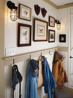 I want to do something like this in my entryway but since it's also my living room, the wainscotting won't work. However, if I extend my mantle for the fireplace along that whole wall (perhaps with bookcases closed/open storage beneath then I could follow that line with a picture rail in my entryway.... Hmmm....