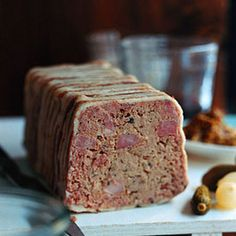 Country Terrine Recipe Appetizers, Main Dishes with finely chopped onion, unsalted butter, garlic cloves, chopped fresh thyme, kosher salt, black peppercorns, whole allspice, grated nutmeg, California bay leaves, heavy cream, large eggs, cognac, chicken livers, fatback, pork shoulder, veal, baked ham, bacon slices