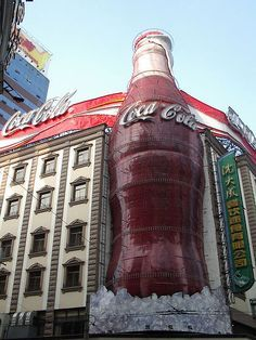 Coca Cola - This also looked really cool at night time when it was all lit up with blinking red and white lights. Photo by Su-chan - taken at People's Square in Shanghai, China. Coke Ad, Coca Cola Ad, Always Coca Cola, World Of Coca Cola, Coca Cola Bottles, Cocoa Cola, Josie Loves, Coca Cola Decor, Guerilla Marketing
