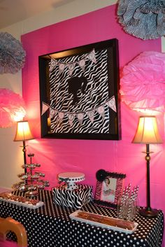 Temporarily cover frames with zebra wrapping paper and Barbie silhouette