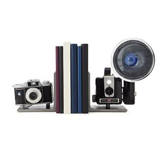 Look what I found at UncommonGoods: vintage camera bookends...