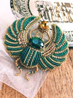 Items similar to Egyptian scarab custom brooch, beetle jewelry embroidered gold on Etsy Handmade Jewelry Bracelets, Beaded Jewelry, Beaded Bracelets, Gold Jewelry, Bracelet Men, Jewelry Art, Jewellery, Bead Embroidery Jewelry, Beaded Embroidery