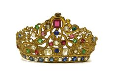 This beautiful multi-coloured tiara dates to the mid 19th Century and once adorned a large statue of the Madonna in a French church.  The large gold-tone crown displays finely detailed craftmanship with ornate swirls and scallops. It has been lavishly decorated with a rainbow assortment of facetted rhinestones. The base of the tiara features an elegant band of alternating sapphire blue and clear stones. The crown has an adjustable head band.  DIMENSIONS Height: 3 1/4  (8 cm) Diameter: 4 1/2…