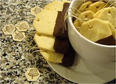 Teabag Shortbread cookies  Use a round frosting tip to cut a hole at the top of each cookie.  Bake cookies, dip in chocolate then thread real thread thru them and print an cut out paper tags.  FREE printable tags