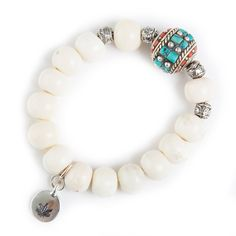 "This bone bracelet is adorned with one Tibetan box cylinder shaped bead with Turquoise and Coral inlays and our silver toned cannabis leaf stamp charm. Bracelet is approximately 6-7"" - If you have a b"
