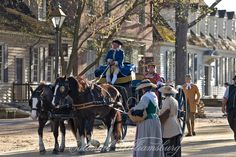 Colonial street scene with carriages. Duke of Gloucester Street in Colonial Williamsburg's Historic Area. Williamsburg, Virginia.