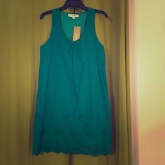 Teal dress This is a racer back style teal dress with tags brand new.  100% Cotten (there is a small white spot from deodorant, I bought it that way) if you have any questions drop me a line! Criss cross Dresses