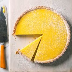 "Classic Lemon Tart We adjusted the ingredients to produce a lemon tart with a silken texture, the perfect balance of tart and sweet, and a taste that isn't too ""eggy. Caramel Chocolate Bar, Caramel Tart, Tart Recipes, Sweet Recipes, Lemon Recipes, Baking Recipes, Pastry Recipes, Kouign Amman, American Test Kitchen"