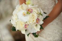 {Stunning Bridal Bouquet: White Phalaenopsis Orchids, White/Pink Cymbidium Orchids, Ivory Roses, White Calla Lilies + Green Foliage}