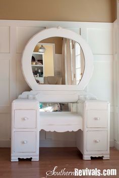 A 1940s Vanity Dresser & Mirror My dad's kid sister had one like this (not painted) that was passed to me in 1965.  Always seemed a little small to me, but would be cool to have now.
