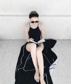 """1,498 Likes, 8 Comments - Filippa K (@filippa_k) on Instagram: """"Postcard from Sicily - our Art Director in the tie back swimsuit, """"busy"""" reading #mindfulholiday…"""""""