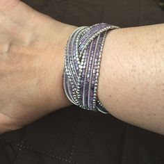 ⬇️ Final ⬇️ Braid Bracelet Sparkly purple and silver beads in 4 braids. Flexible stretch. One of my faves but just never wore enough. Always got compliments when I did though. This low price must be bundled. Pier 1 Jewelry Bracelets