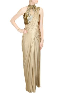 Buy Gold shimmer pre stitched drape sari with embroidered blouse online in India at best price.Gaurav Gupta presents Gold shimmer pre stitched drape sari with embroidered blouse available only at Saree Gown, Satin Saree, Sari, Silk Satin, Designer Sarees Wedding, Designer Sarees Online, Buy Gowns Online, Indowestern Gowns, Golden Saree